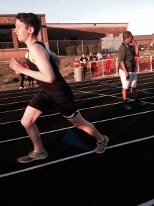 Jacob C represents Cherokee Creek Boys Boarding School at a local high school track meet.