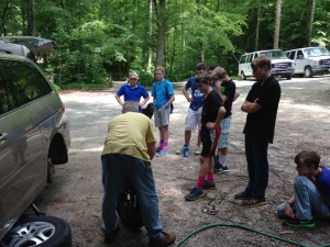 boys boarding school students learn to change a tire