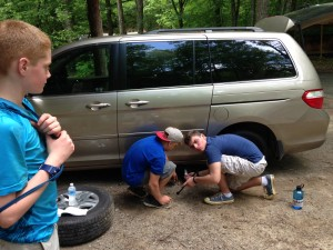 boys boarding school students like to change a tire